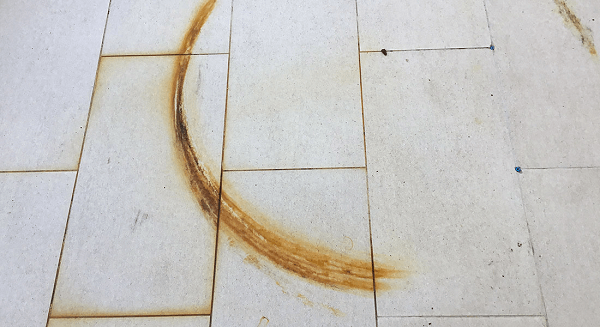 rust from tiles and grout